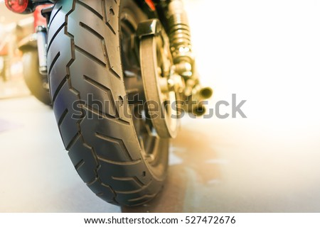 Motorcycle Tyre Big bike - Closeup Rear wheel of Bigbike motorcycle at the city street Technology Superbike and Transportation Background concept #527472676