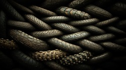 Motorcycle tyres stacked in a tyre distribution centre create a herringbone pattern. Post process treated to give a menacing look