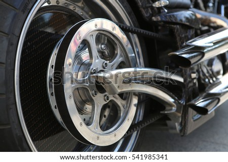 motorcycle wheel. motorcycle chain. exhaust pipe. #541985341