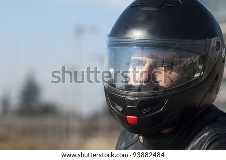 Motorcycle with his helmet
