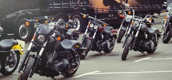 motorcycles stand in the parking lot waiting for riders, side view of the motorcycle, moto trips. panoramic shot of the banner.
