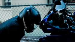 Motorcyclist admiring his bike.