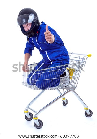 motorcyclist in blue coveralls and black helmet in shopping cart, thumb up