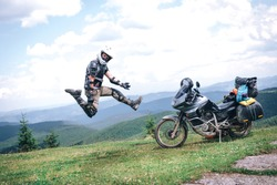 Motorcyclist man rock and roll jump, Adventure Motorbike on the top of the mountain. Motorcycle trip. off road Traveling, Lifestyle Travel vacations sport outdoor concept.