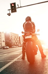 motorcyclist on the road with the setting sun