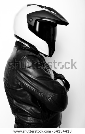 Motorcyclist with helmet and leather jacket
