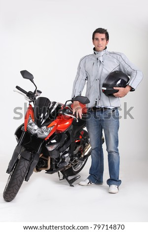 Motorcyclist with his motorbike