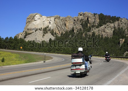 Motorcyclists drive on the road to Mount Rushmore National Memorial, South Dakota.