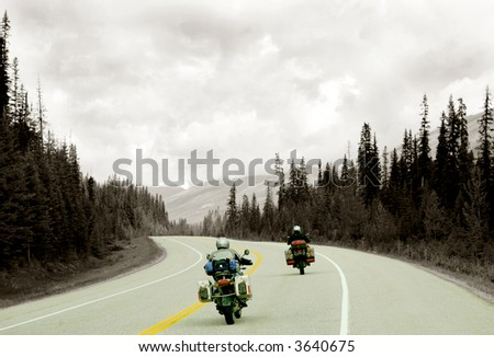 Motorcyclists on mountain road in Yukon, Canada