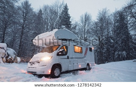 motorhome camper van in the nature, nomad van life for traveler in the winter holiday