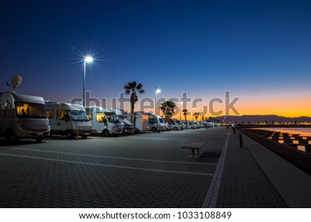 Motorhome parking in Gibraltar by night. RV parking in the front of the sea. Beautiful camping holiday in the summer.