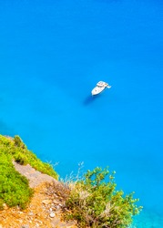 Motorized cruiser boat in the blue sea of Amorgos island in Greece