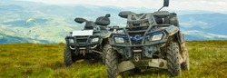Motorsport in the mountains. Two ATVs on top of a mountain