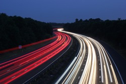 Motorway traffic light trail on a summer evening, England, Great Britain