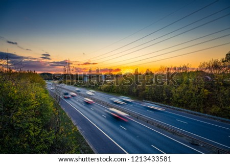 Motorway with blurry cars at sunset