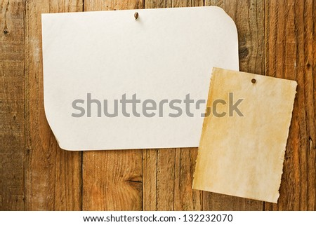 mottled beige parchment paper posters similar to the grungy cowboy wanted notices nailed to vintage wooden planks
