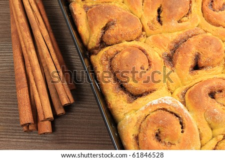 Mould with fresh hot pumpkin buns with spices