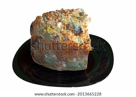 mouldy piece of bread on dark plate, isolated obver white background Stock photo ©