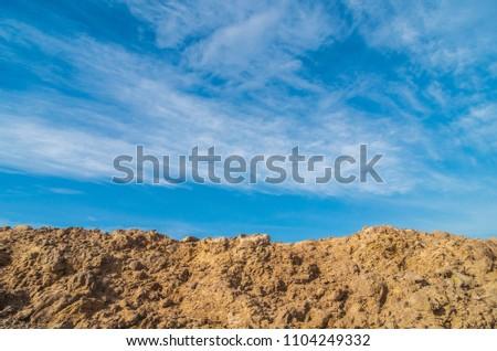 Mound and blue sky #1104249332