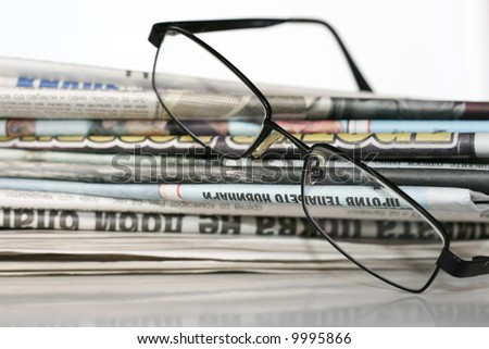 Mound of newspapers and glasses
