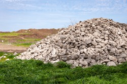 Mound of stones on the grave. Grave mound made of stones, concept of ancient architecture, tourism, travel, fortress.