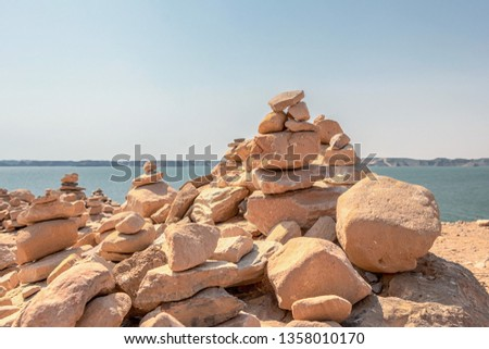 Mound of stones placed conically one above the other, as an offering made by tourist in Abu Simbel, Aswan, Egypt