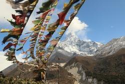 Mount Ama Dablam and tibetan prayer flags view from Khumbu valley Everest base camp trek Sagarmatha National Park Nepal