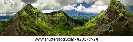 Mount Batur one of the famous volcanos in tropical island Indonesia / Batur volcano and Batur lake, panoramic view / Bali, Indonesia