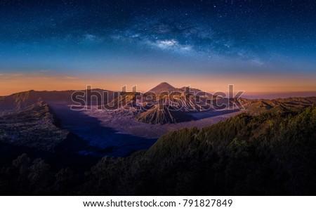 Mount Bromo volcano (Gunung Bromo) on night sky with milky way in Bromo Tengger Semeru National Park, East Java, Indonesia.