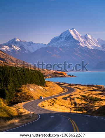 Mount Cook standing high above the blue waters of Lake Pukaki in New Zealand's South Island. #1385622269