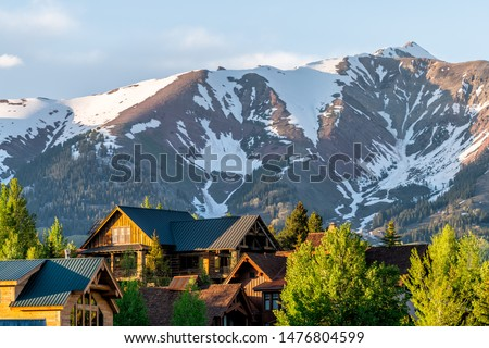 Mount Crested Butte Colorado village houses in summer with colorful sunset on green trees and lodging Сток-фото ©