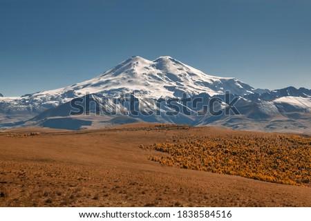 Mount Elbrus. Autumn Elbrus. Autumn in the Caucasus mountains. Jilly-Su region. White snow big mountains. Snow peaks. Panorama of Elbrus.