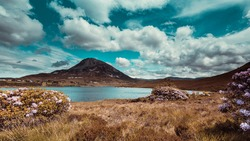 Mount Errigal, Co. Donegal, Ireland, Mount Errigal, Co. Donegal, Ireland, reflected in blue lake surrounded by peatland in national park