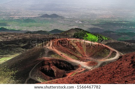 Mount Etna, Sicily - Tallest active volcano of Europe 3329 m in Italy. Panoramic wide view of the active volcano Etna, extinct craters on the slope, traces of volcanic activity.