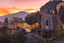 Mount Etna volcano at sunset, as seen from Taormina, Sicily