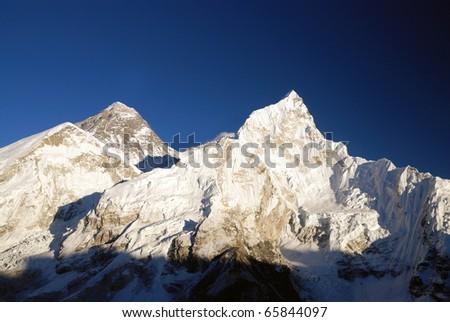 Mount Everest and Nuptse taken from the summit of Kala Patthar, Nepal - stock photo