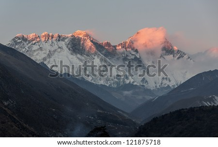 Mount Everest (8848 m) and Lhotse (8511 m) in the last light of the Sun (view from Tengboche monastery) - Nepal, Himalayas