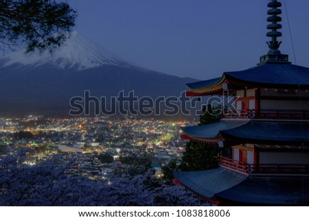 Mount Fuji and Chureito Pagoda at night in spring, Japan. The Pagoda is in Arakura Sengen Shrine one of the most famous tourist attraction where tourist can see Mt Fuji from panoramic view #1083818006