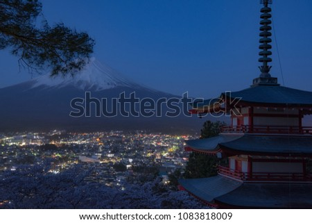 Mount Fuji and Chureito Pagoda at night in spring, Japan. The Pagoda is in Arakura Sengen Shrine one of the most famous tourist attraction where tourist can see Mt Fuji from panoramic view #1083818009