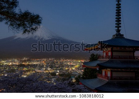 Mount Fuji and Chureito Pagoda at night in spring, Japan. The Pagoda is in Arakura Sengen Shrine one of the most famous tourist attraction where tourist can see Mt Fuji from panoramic view #1083818012