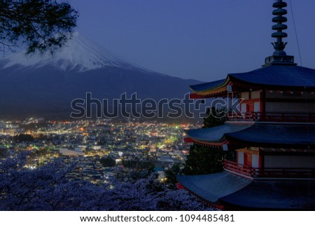 Mount Fuji and Chureito Pagoda at night in spring, Japan. The Pagoda is in Arakura Sengen Shrine one of the most famous tourist attraction where tourist can see Mt Fuji from panoramic view #1094485481
