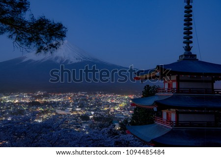 Mount Fuji and Chureito Pagoda at night in spring, Japan. The Pagoda is in Arakura Sengen Shrine one of the most famous tourist attraction where tourist can see Mt Fuji from panoramic view #1094485484