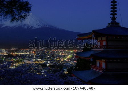 Mount Fuji and Chureito Pagoda at night in spring, Japan. The Pagoda is in Arakura Sengen Shrine one of the most famous tourist attraction where tourist can see Mt Fuji from panoramic view #1094485487
