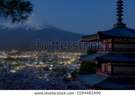 Mount Fuji and Chureito Pagoda at night in spring, Japan. The Pagoda is in Arakura Sengen Shrine one of the most famous tourist attraction where tourist can see Mt Fuji from panoramic view #1094485490