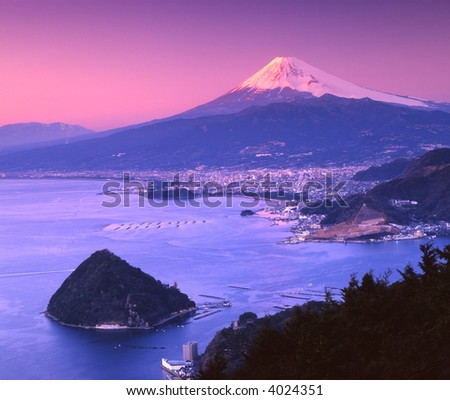 Mount Fuji at night with Suruga Bay in foreground