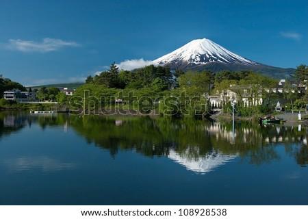 Mount Fuji from Kawaguchiko lake in Japan during the sunrise with beautiful blue sky - stock photo