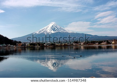 Stock Photo Mount. Fuji is a physical, Cultural ad Spiritual symbol of Japan, located on Honshu island, is the highest mountain in Japan.