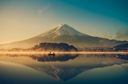 Mount fuji san at Lake kawaguchiko in japan on sunrise.  vintage tone