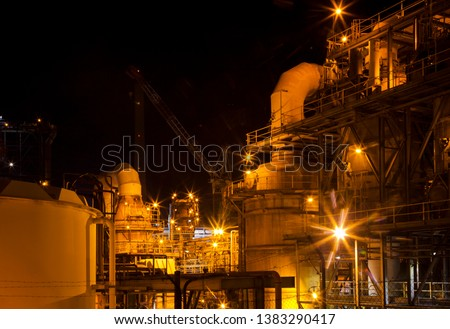 Mount Isa Mine Processing Plant. Industrial sulphuric acid plant containing 3 stage catalytic conversion, gas cleaning and drying towers, Copper Smelting. Illuminated night shot of acid plant.