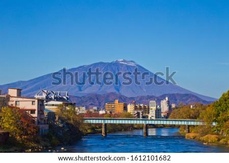 Mount Iwate scene with buildings and promenade at Katakami river in  Morioka city, Iwate, Japan Stock photo ©